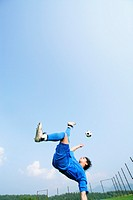 Soccer player doing overhead kick