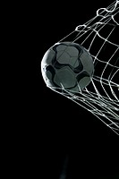Soccer ball hitting back of net