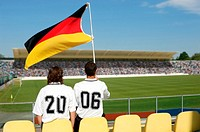 Two soccer friends wearing 2006 on their shirts with German flag