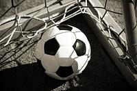 Football lying in a goal