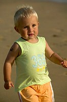 Little boy running on the beach