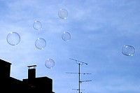 Bubbles floating in sky