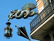 Façade with dragon and umbrella. Las Ramblas. Barcelona. Spain