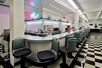 Fifties style diner with black and white checkerboard floor. Alaska. United States