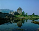 architecture, bridge, Britain, building, calm, canoe, canoeists, canoes, castle, coast, daytime, Dornie, Eilean Dona
