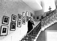 The Prime Minister on the Grand Staircase which was built to a cantilever design with no visible supports. Framed portraits of every prime minister ar...