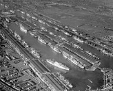 Aerial view of the Royal Docks, London, looking north-west, November 1957.