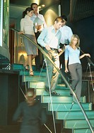 Businesspeople walking down stairs together