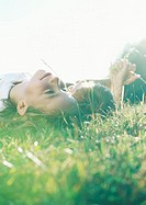 Boy and girl lying on grass together