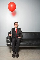 Businessman holding a balloon