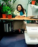 Woman surrounded by plants in office