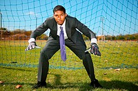 Businessman standing in goal