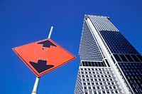 Road sign and skyscraper