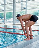Male swimmer preparing to dive