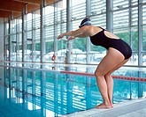 Female swimmer preparing to dive