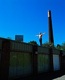 Gymnast on garage roof
