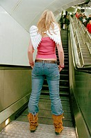 Woman standing near escalator