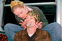 Couple playing on subway train