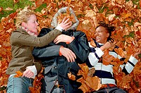 People playing in leaves