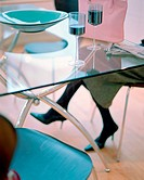 Woman sitting at glass table