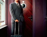 Businessman outside hotel room