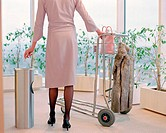 Woman with luggage trolley