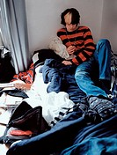 Teenage boy relaxing on bed