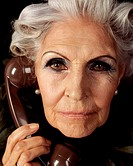 Glamourous senior woman on telephone