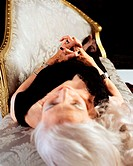 Glamourous senior woman lying down
