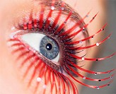 Woman with red false eyelashes