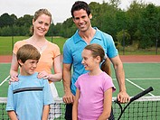 Family on tennis court