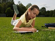 Girl doing homework in a park