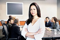 Businesswoman standing in front of group