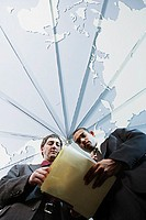 Low angle view of two businessmen reading papers