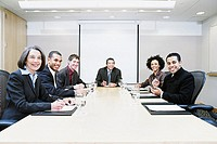 Group portrait of businesspeople in meeting