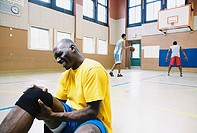 Man with knee injury on basketball court