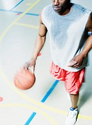 High angle view of man dribbling basketball