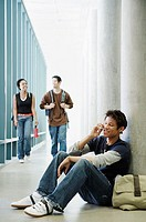 Three college students in corridor