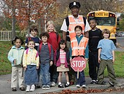 Group of children with crossing guards