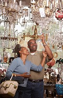 Couple shopping in antique store (thumbnail)