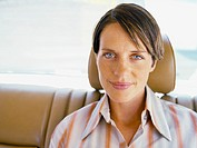 Woman sitting in back of car