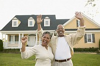 Portrait of senior couple waving