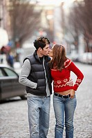Couple kissing in the street, Richmond, Virginia, United States