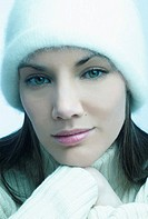 Headshot of woman wearing winter cap