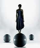 Woman standing on sphere