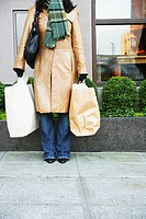 Low section of woman with shopping bags (thumbnail)