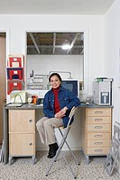 Portrait of woman in home office