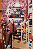 Woman working in yarn shop