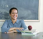 Teacher sitting at her desk