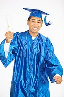 Portrait of teenage boy in cap and gown